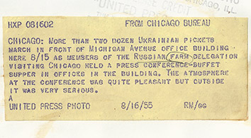 1955, August 15. HB. Chicago, Illinois. More than two dozen Ukrainian pickets march in front of Michigan Avenue office building here 8/15 as members of the Russian farm delegation visiting Chicago held a press conference-buffet supper in offices in the building. The atmosphere at the conference was quite pleasant but outside it was very serious. United Press Photo (Back)