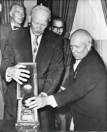 1959, September 15. EA. Washington, District of Columbia. MOON-ROCKET MODEL: President Eisenhower is examining a model of the sphere, which a Soviet moon rocket landed on the Moon. Soviet Premier Khrushchev gave him the model during a series of White House Talks. AP Wirephoto (Front)