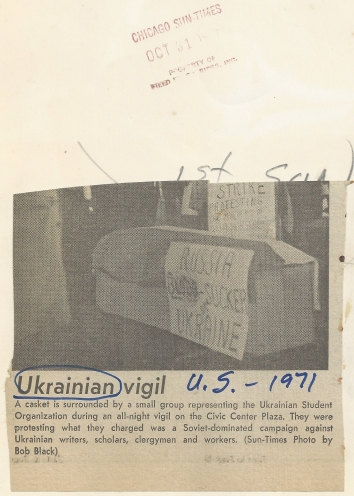 1971, October 30. FB. Chicago, Illinois. A casket is surrounded by a small group representing the Ukrainian Student Organization during an all-night vigil on the Civic Center Plaza. They were protesting what they charged was a Soviet-dominated campaign against Ukrainian writers, scholars, clergymen and workers. Chicago Sun-Times (Back)