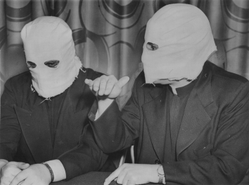 1951, November 26. BA. New York, New York. Faced masked, Ukrainian priests tell of Red oppression. Acme Telephoto (Front)