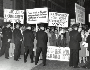 1958, October 18. CA. Milwaukee, Wisconsin. Brandishing placards, a booing ant catcalling crowd expressed its disapproval of Russian Ambassador Mikhail A. Menshikov's appearance Friday night at the Woman's Club of Wisconsin, 813 E. Kilbourn av (Front)