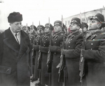 1959, March 2. AA. Kyiv, Soviet Ukraine. Wearing a black fur cap, British Prime Minister Macmillan inspected an honor guard of Russian troops on his arrival at Kyiv from Moscow. Macmillan was in Russia to explore east-west attitudes on major issues including Berlin and Germany. AP Wirephoto (Front)