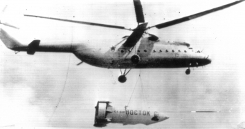 "1961, July 9. FA. Moscow, Soviet Russia. A giant helicopter Mi-6 carries ""Vostok,"" Gagarin's space capsule (or its replica) during air parade 7/9. UPI Radiotelephoto (Front)"