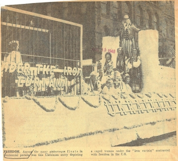 1948, August 15. AB. FREEDOM. Among the many picturesque floats in Centennial parade was this Ukrainian entry depicting a caged woman under the