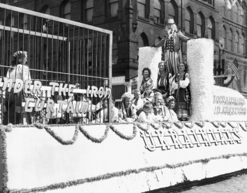 1948, August 15. AA. FREEDOM. Among the many picturesque floats in Centennial parade was this Ukrainian entry depicting a caged woman under the