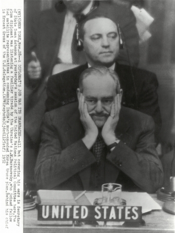 1952, November 28. CA. New York, New York. A DIPLOMAT'S JOB HAS ITS DRAWBACKS -  Secretary of State Dean Acheson listening to Ukraine's A.M.Baranovsky at UN Political Committee session. AP Wirephoto (Front)