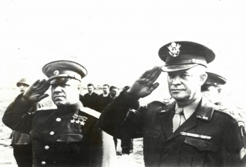 "1945, August 11. EA. Moscow, Soviet Russia. ""IKE"" ARRIVES IN MOSCOW.  Marshal Gregory Zhukov and General of the Army Dwight O. Eisenhower (Right) salute as the American and Russian national anthems are played at Moscow airport. ACME Radiophoto (Front)"