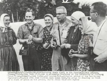 1955, August 2. DA. Soviet Ukraine. During their visit in Ukraine, D. Gale Johnson, former Viton Iowa farm youth, now an economics professor at the University of Chicago; Ralf Olsen, Elsworth Iowa farmer, and Lauren Soth, editorial editor of the Des Moines Register (L-R), talk with some Russian farm women here. United Press Telephoto (Front)