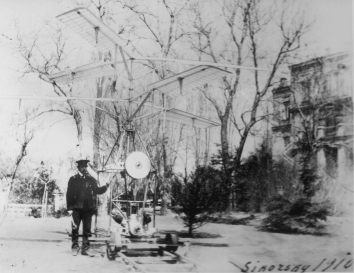 1910. AA. Kyiv, Ukraine. Ihor Sikorsky with H-2 (second helicopter prototype) in the backyard of the Sikorsky Family house at 15Б Yaroslaviv Val Street, Kyiv, Ukraine.  A copy of the photograph is posted in the U.S. Embassy in Ukraine building at 4 Aviaconstructor Ihor Sikorsky Street, Kyiv, Ukraine. Provided by the Sikorsky Family and Robert Homans.